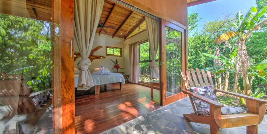 The Jungle cabins of Mystica Lodge and Retreats offer a private deck from where you enter the room. The room has a sliding door and two glass walls to make you feel one with nature.